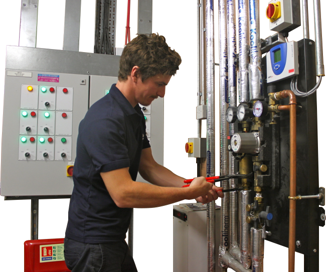 Clipped photo of John of JJM Gas Services working on a solar pumping system.