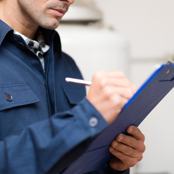 Thumbnail photo of a gas engineer compiling a boiler service report.